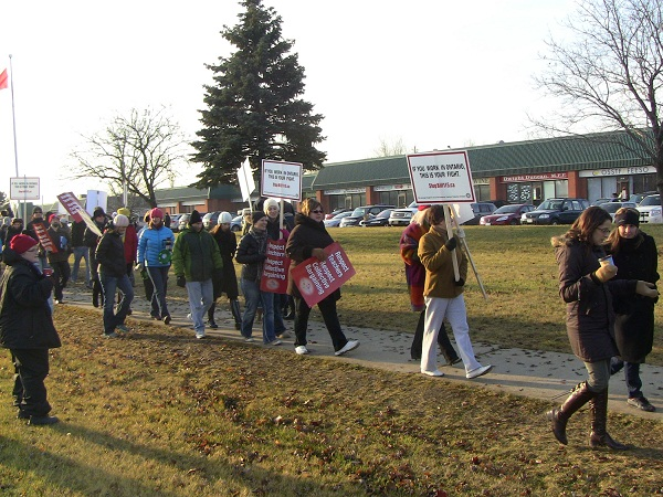 Teachers hold a protest at MPP Dwight Duncan's office on Dec. 18, 2012.