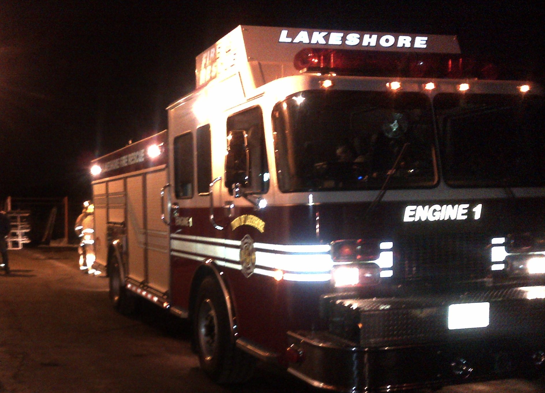 Lakeshore fire crews wait outside of A.P. Plasman building for an update on robotics fire. (Photo by Ricardo Veneza)