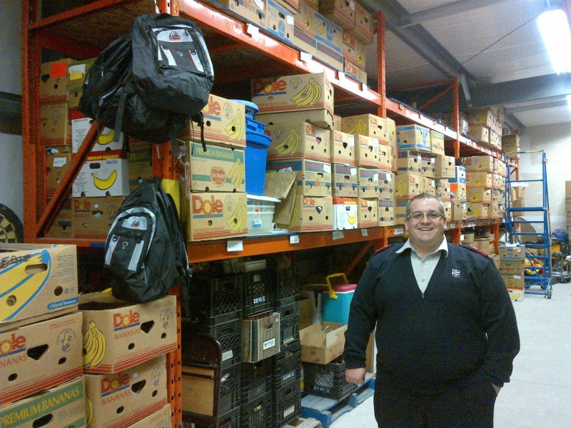 Salvation Army Captain Corey Vincent stands inside the Leamington warehouse.