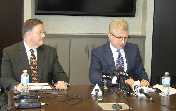 Windsor lawyer Greg Monforton and Michigan lawyer Robert Darling address the media after a 2013 fatal crash on I-75 in Detroit. (Photo by Maureen Revait.)