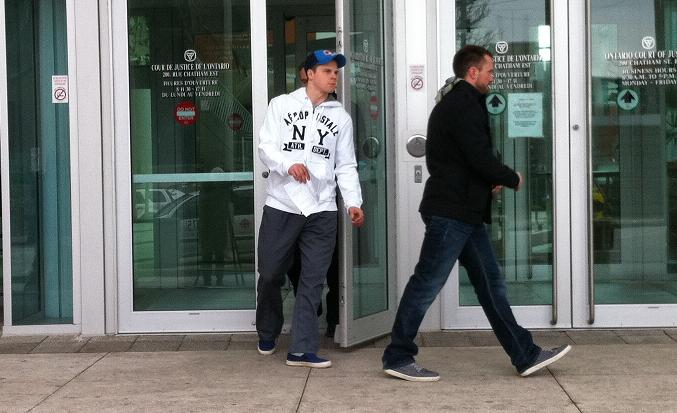 Windsor Spitfires' forward Ben Johnson (left) leaves the courthouse in downtown Windsor after a bail hearing this morning, March 19, 2013.