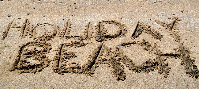 """""""Holiday Day"""" is written int he sand. (Photo courtesy ERCA.org)"""