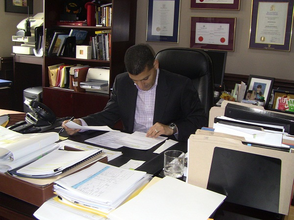 BlackburnNews.com file photo, Windsor Mayor Eddie Francis working in his office.