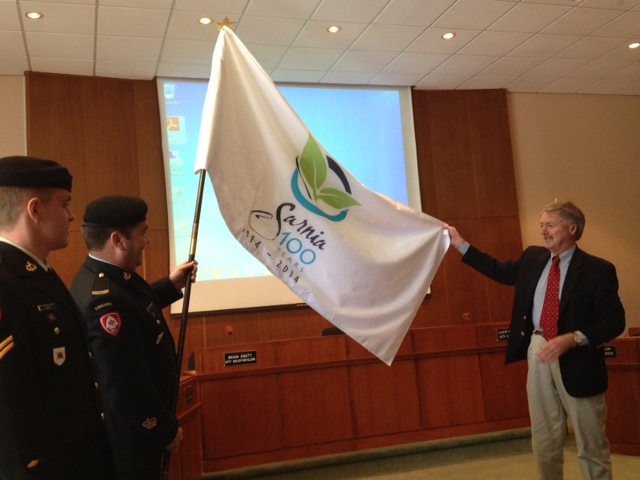 Mayor Mike Bradley proudly displays a flag marking Sarnia's 100th Anniversary. BlackburnNews.com