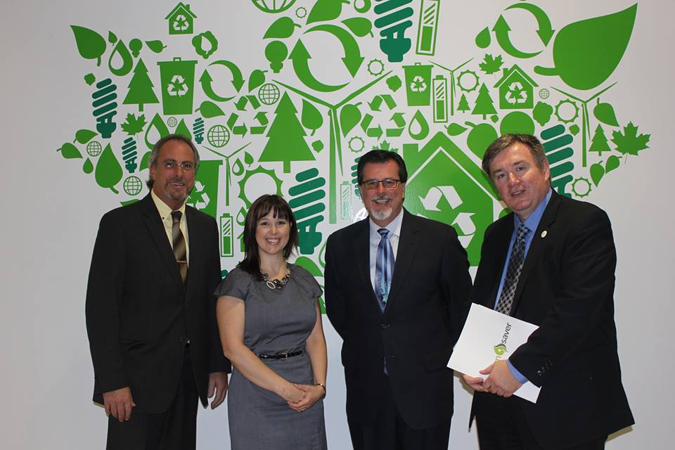 Chatham-Kent Mayor Randy Hope with, from left to right, Erin Bourdeau and Jim Hogan from Entegrus and Vladan Veljovic with Green Saver at the Home Assistance Launch.