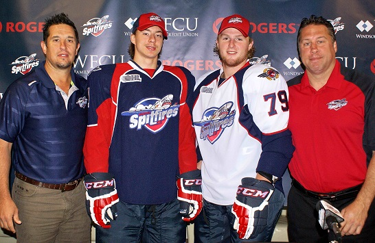 Windsor Spitfires' Head Coach Bob Boughner, forwards Nikita Yazkov and Ty Bilcke, along with GM Warren Rychel, showing off the 2013-2014 jersey.
