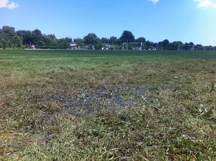 Sports fields at the Ford Test Track in Windsor saturated with water, July 11, 2013.