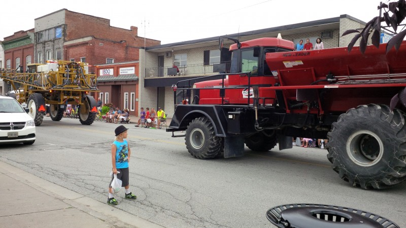 Tractors roll along downtown Harrow as part of the 2013 Harrow Fair Parade.