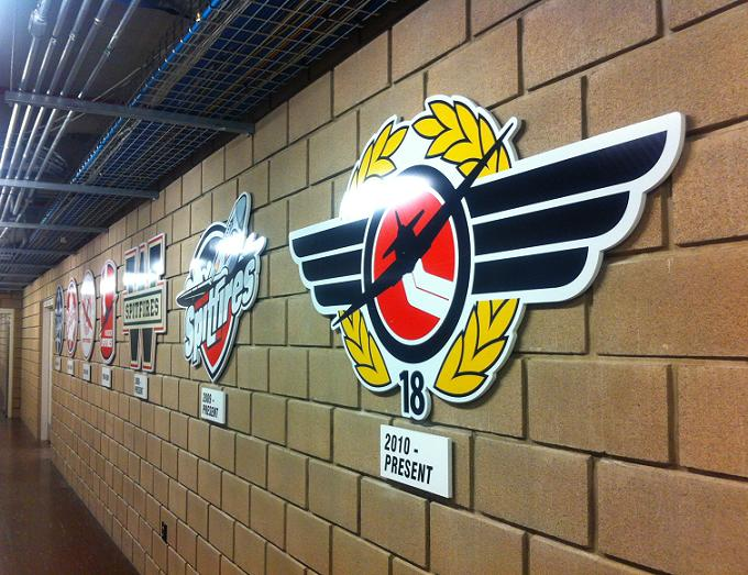 Windsor Spitfires' logos, past and present, in the hallway outside of the team's dressing room at the WFCU Centre. (Photo by Mike Vlasveld.)