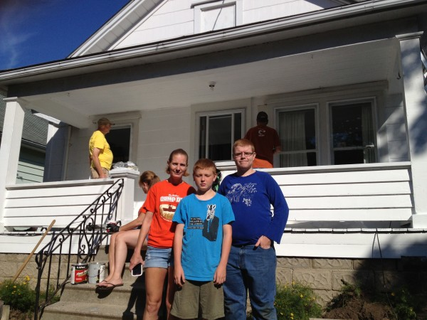 Liz Huff stands in front of her home with two of her sons, Zachary and Tim. (Photo by Matt Weverink)