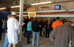Fans line up to bet on horse races at the Leamington Fairgrounds. (Ricardo Veneza)