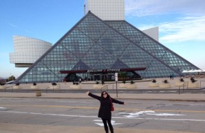 Lisa Brandt posing in front of the Rock and Roll Hall of fame.