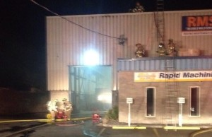 Tecumseh firefighters attend an industrial building on County Rd. 42 to battle an interior fire, December 5, 2013. (Photo courtesy of Tecumseh Fire, via Twitter.)