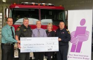 Pictured:  Jeff Roy Excalibur Insurance, Morris-Turnberry Community Fire Safety Officer James Marshall,  Paul Whettlaufer Excalibur Insurance,  Una Roy Excalibur Insurance,   Huron East Fire Chief Marty Bedard.