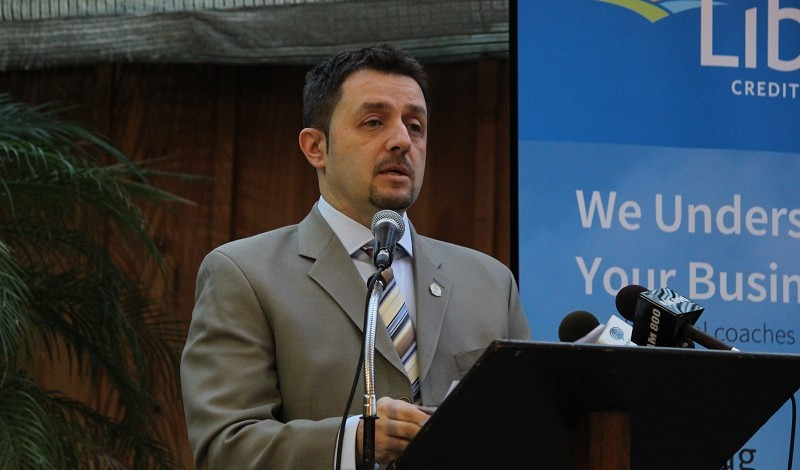 Nelson Santos speaking at the 2014 Mayors Breakfast. (Photo by Maureen Revait)