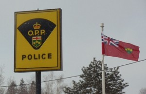 OPP sign and Ontario flag