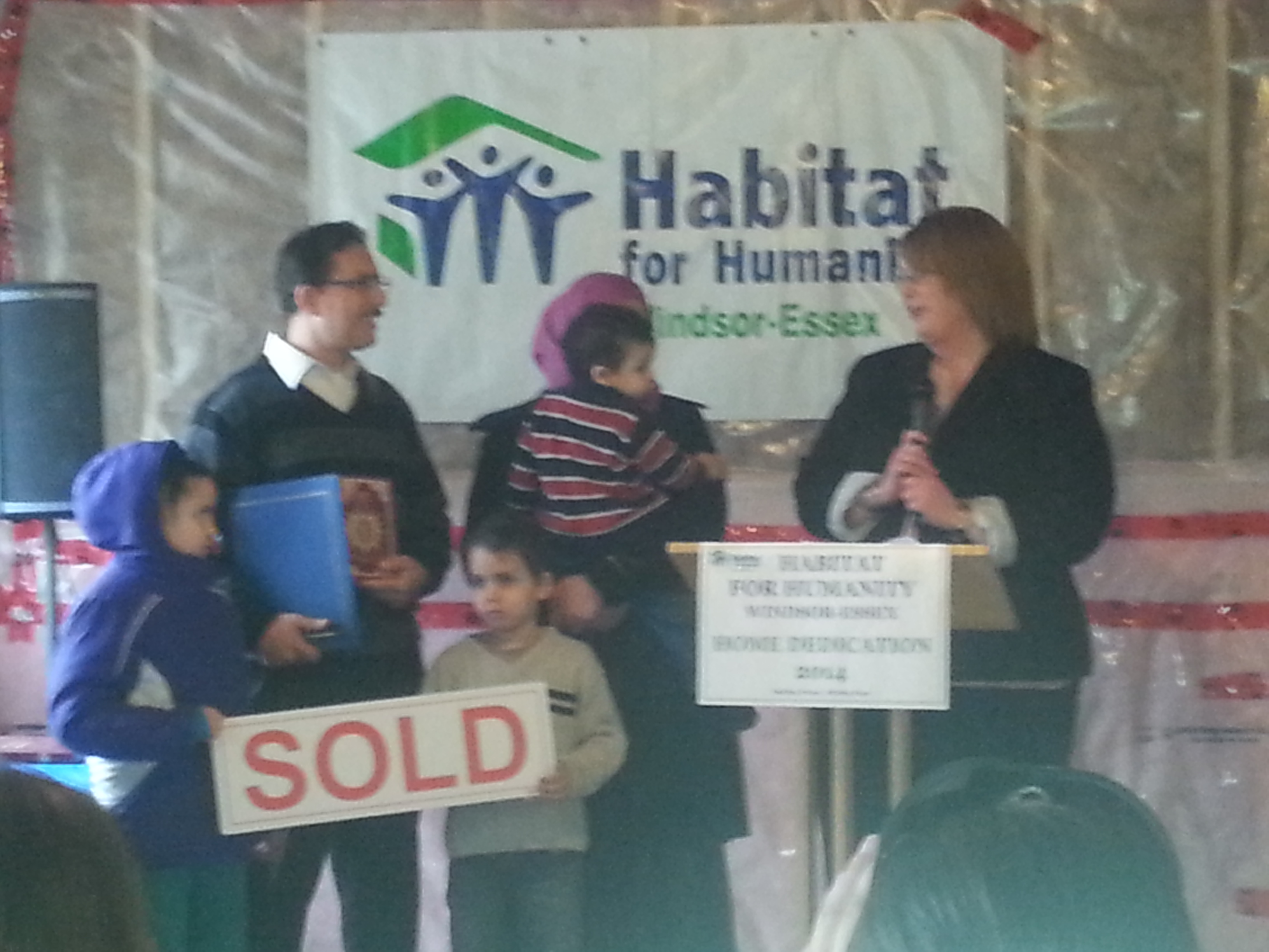 The Laib family moves into their new home as the Windsor-Essex Habitat for Humanity holds it 55th dedication ceremony in Windsor on March 22, 2014.