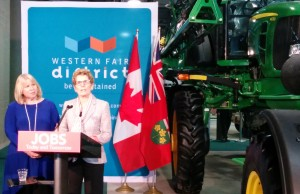 Premier Kathleen Wynne takes questions from the media at the 2014 Farm Show.