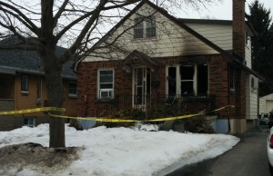 Firefighters taped off 80 Sterling St. on Tuesday after fire ripped through the main floor.