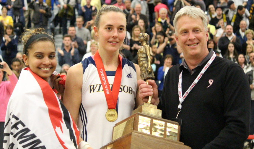 Windsor Lancers stars Miah-Marie Langlois (L) and Jessice Clemencon (C) hold the Bronze Baby Trophy. March 16, 2014. (Ricardo Veneza)