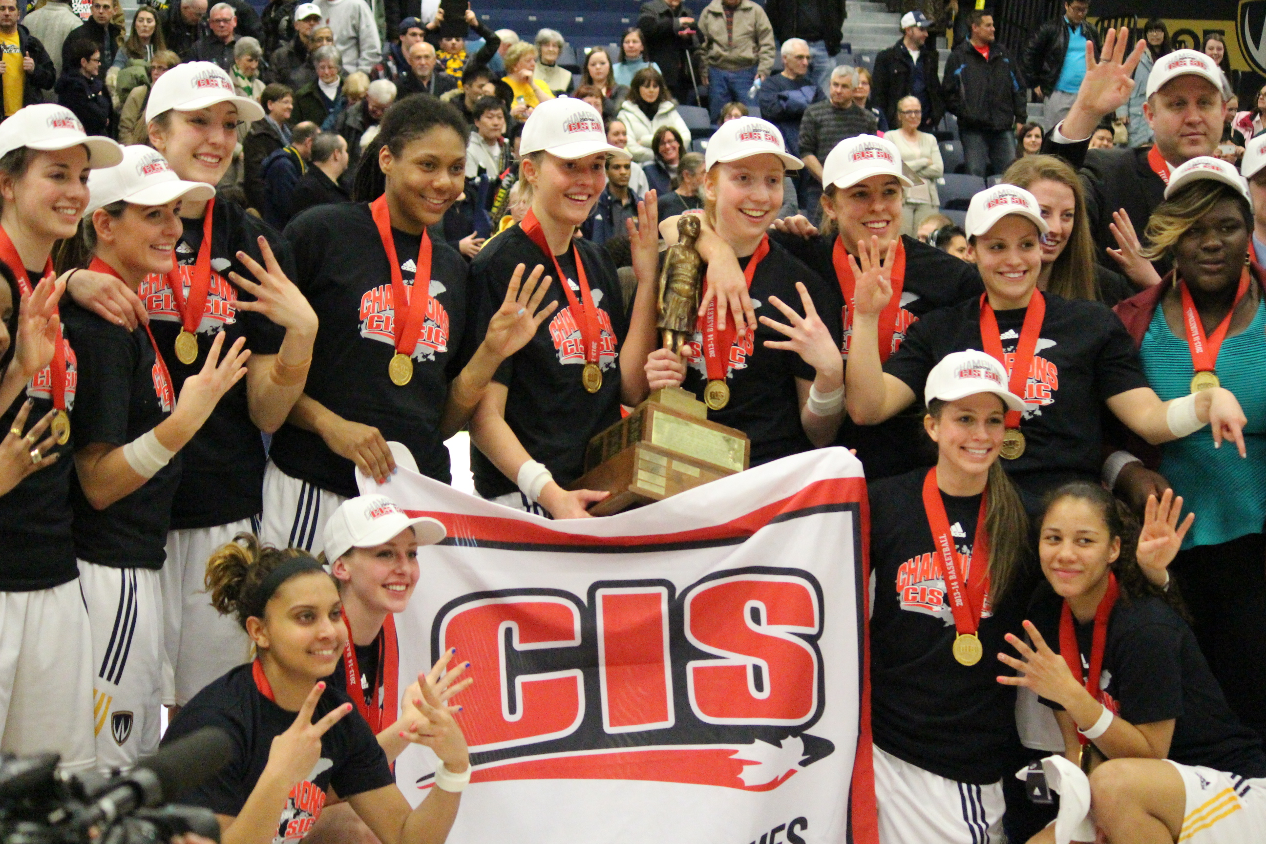 The Windsor Lancers pose for their team photo after winning the 2013/2014 CIS Women's Basketball Championship. March 16, 2014. (Ricardo Veneza)