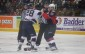 Windsor Spitfires defenceman Slater Koekkoek fights Sanginaw Spirit forward Jeremiah Addison, March 6, 2014.