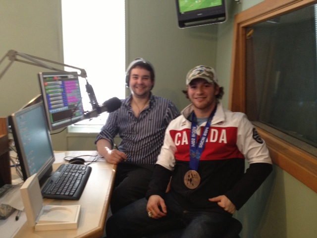 Tyler McGregor shows off his bronze medal while appearing on CHOK's The Sports Show Mar. 25, 2014