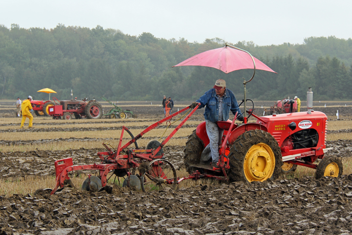 Tractor plowing through field. (Photo courtesy www.plowingmatch.org)