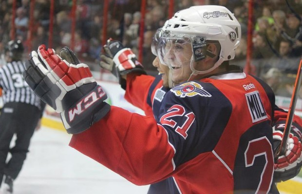 Windsor Spitfires forwards Brody Milne (closest) and Josh Ho-Sang celebrate a goal on home ice against the Saginaw Spirit, March 6, 2014. (photo by Mike Vlasveld)