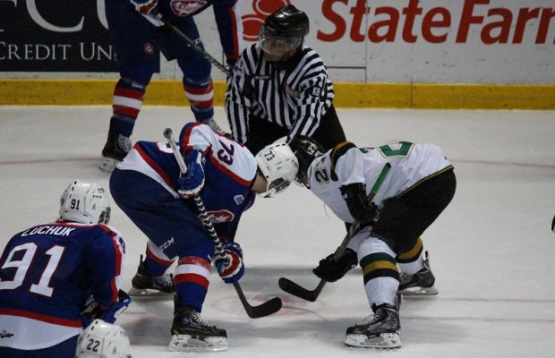Windsor's Remy Giftopoulos faces off against London's Brett Welychka, March 25, 2014.