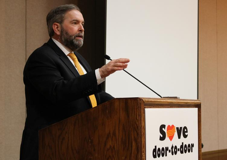NDP Leader Thomas Mulcair talks to CUPW members at the Coboto Club in Windsor, March 20, 2014.