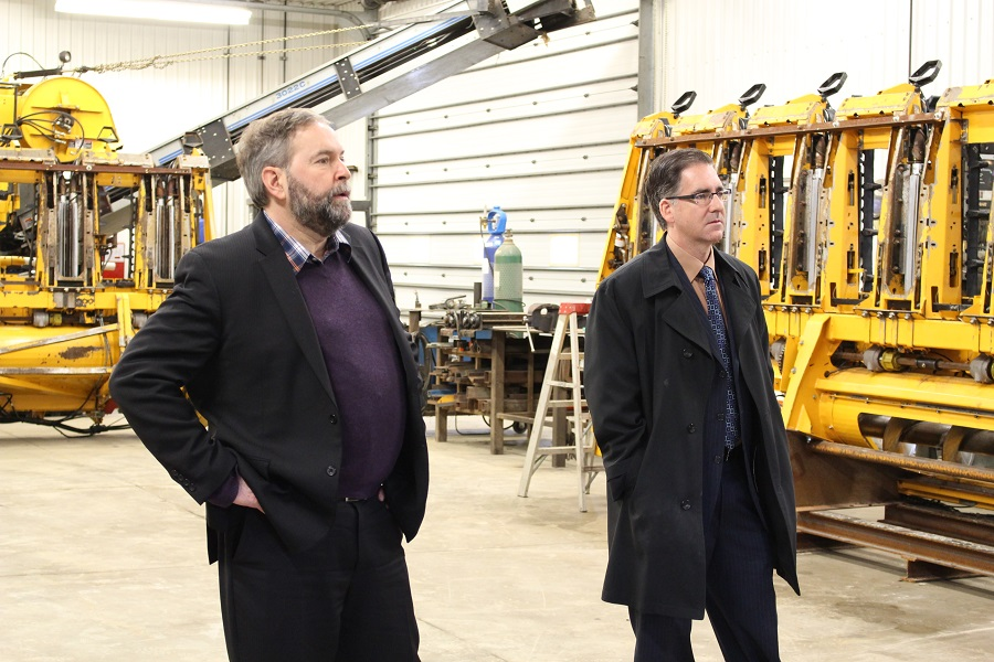 NDP leader Thomas Mulcair and MP for Windsor-West Brian Masse speak to farmers in McGregor.