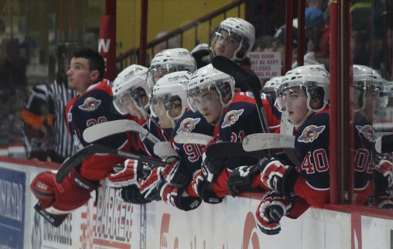 Windsor Spitfires' players lean over the bench during a home game, March 6, 2014. (photo by Mike Vlasveld)