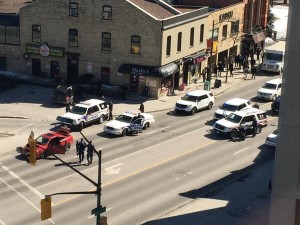 London police block the intersection of Richmond St. and Dufferin St. on Monday, after stopping a vehicle that was believed to contain a gun.