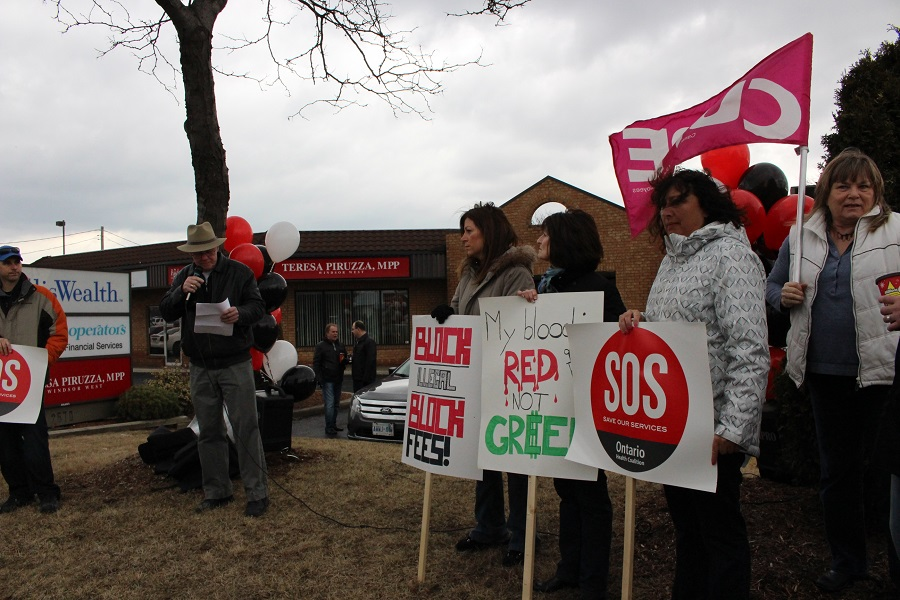 The Ontario Health Coalition rallying in front of MPP Teresa Piruzza's office, March 28, 2014.