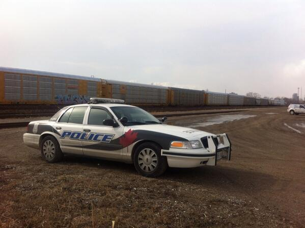 A Windsor police cruiser is parked at the CP Rail Yard on Caron Ave. after a severed human hand is found.