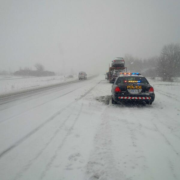 An OPP cruiser sits at the side of Wonderland Rd. near Hwy. 402. Photo by OPP via Twitter
