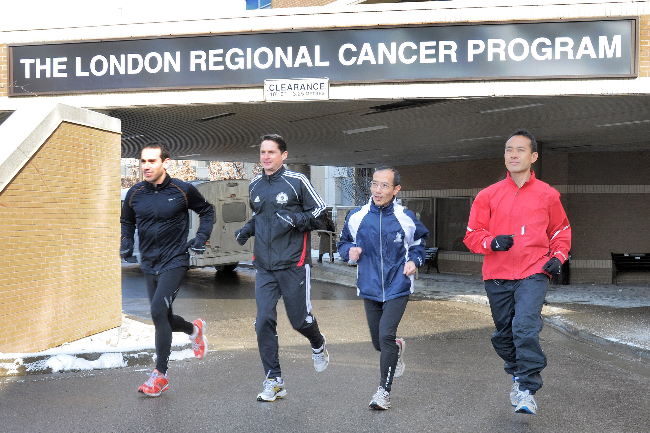 """42k for Cancer"" runners (left - right) Dr. David Palma, Richard McClelland, Dr. Joseph Chin and Dr. Kevin Fung are challenging the Boston Marathon to help raise funds for cancer research and patient care. Courtesy of the London Health Sciences Foundation."