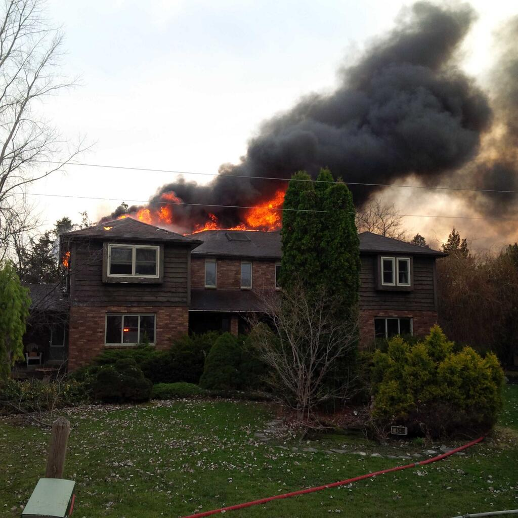Firefighters responded to a house fire on Poppe Line in Tilbury, on April 12, 2014. (Photo courtesy of the Chatham-Kent Fire Department via Twitter.)