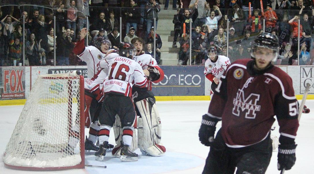 The Leamington Flyers celebrating their Western Conference Championship win over the Chatham Maroons, April 4 2014. (photo by Mike Vlasveld)