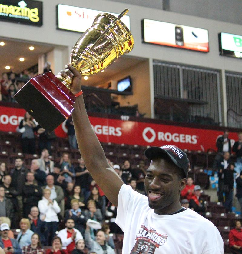 Chris Commons of the Windsor Express hoists the NBL Canada championship trophy. April 17, 2014. (Photo by Mike Vlasveld)
