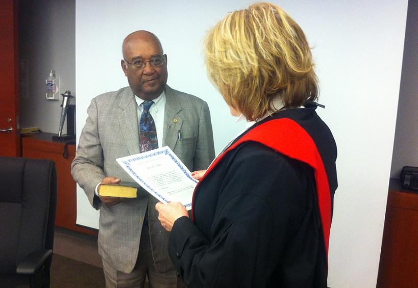 Dr. Gaston Franklin is sworn in as the newest member of the Windsor Police Services Board, April 24, 2014. (Photo by Mike Vlasveld)