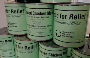 Meat cans prepared by volunteers for the Mennonite Central Committee on April 15, 2014. (Photo by Ricardo Veneza)