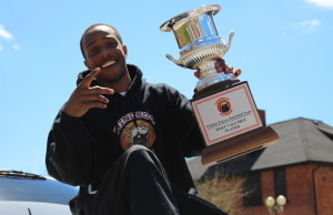 Windsor Express guard Stefan Bonneau with his MVP trophy during the team's championship parade along Ouellette Ave. on April 26, 2014. (Photo by Ricardo Veneza)