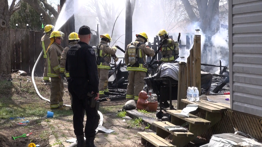 Fire crews at the scene of a shed fire on Harvey St. Apr 27 2014. (Photo by Trevor Thompson, BlackburnNews.com)