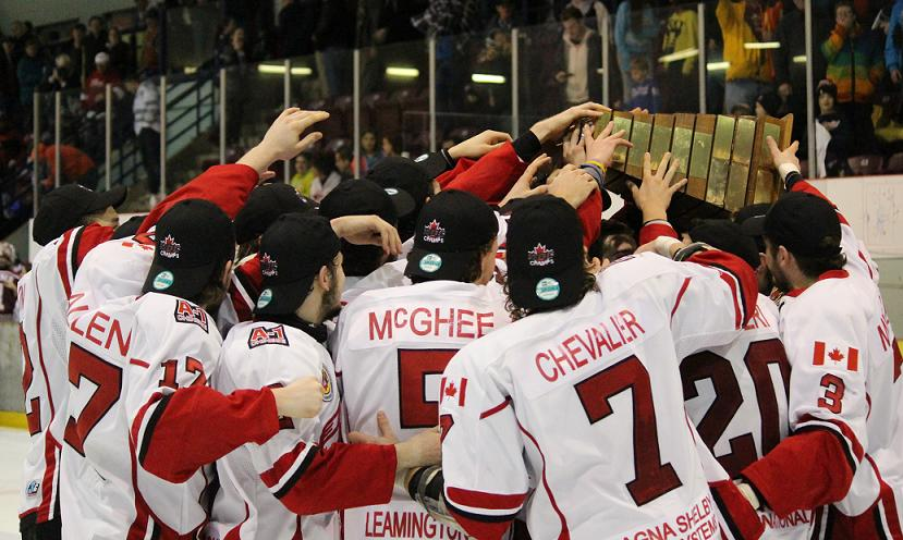 The Leamington Flyers hoist the Bill Weir Trophy, as GOJHL Western Conference Champions. April 3, 2014. (Photo by Mike Vlasveld)