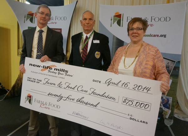 Bill Revington (left) and Nadine Schwandt (right) present a cheque on behalf of New Life Mills to Bruce Christie, chair of the Farm & Food Care Foundation. The cheque represents a five-year pledge of $75,000 to the Foundation.  (Photo provided by Farm & Food Care)
