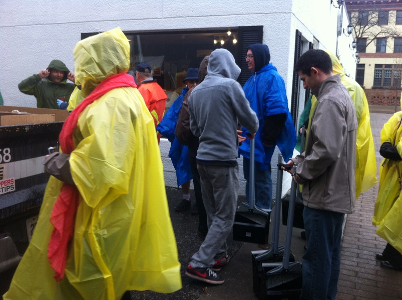 Volunteers pick up their gear to help clean-up the city centre.