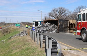 Steel truck looses its load on the E.C. Roe Express Way west bound on-ramp at Central Ave. April 24, 2014