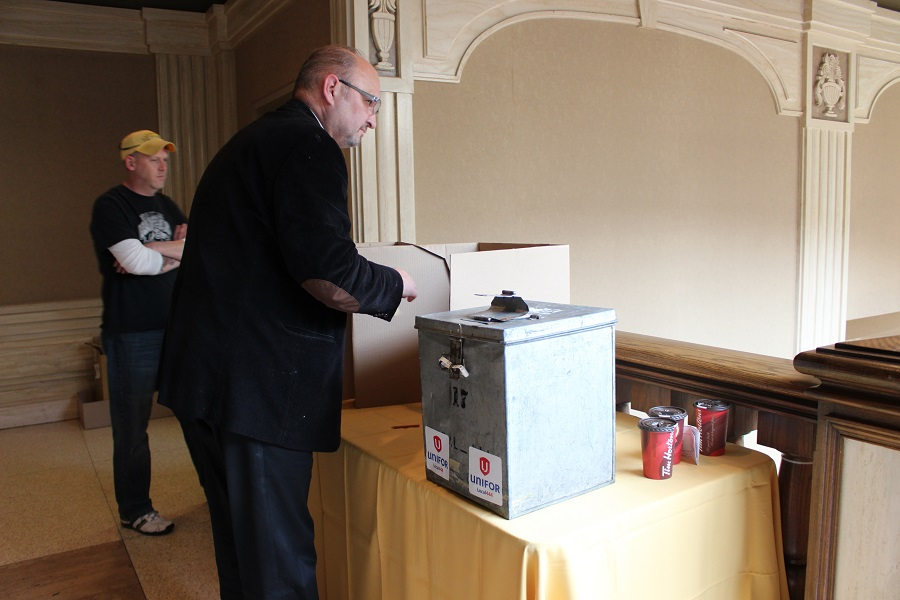 A member of Unifor Local 444 casts their ballot during the ratification vote for Caesars Windsor contract.